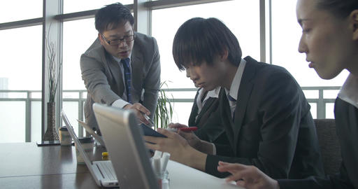 Japanese Business Team Work On A Project Together stock footage