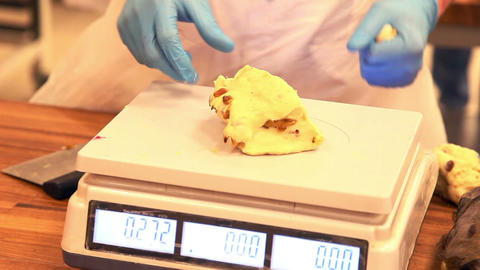 Dough Is Weighed On A Scale At The Bakery stock footage