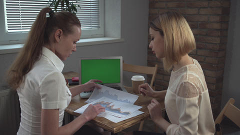 Two Women Discuss Project Work stock footage