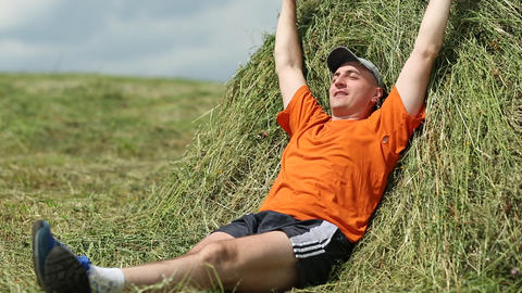 Man Lying On A Haystack. Physical And Mental Relaxation stock footage