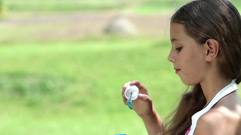Attractive Girl Blowing Soap Bubbles stock footage