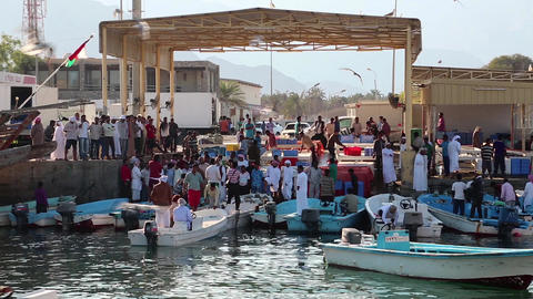 People At Fish Market In Dibba Al-Baya Harbor, Sultanate Of Oman stock footage