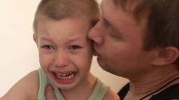 Child Crying Angry, And Beats His Father,father Of The Child Calms stock footage