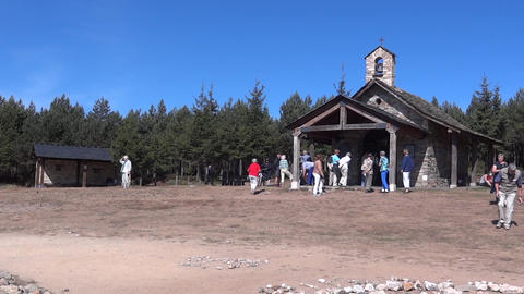 Older age group of tourists who walks in front of the church built in Cruz de Fe Footage