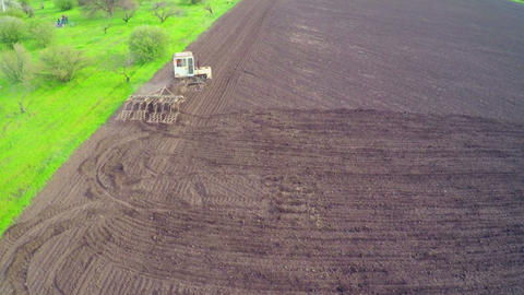 Aerial Of Old Tractor On Harvest Field stock footage