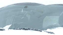 Close-up Of Windshield Wipers Brushing Away The Snow stock footage