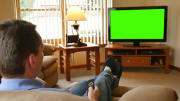 4K Man At Home Watches Television And Channel Surfs stock footage