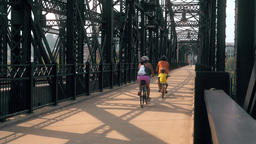 Hot Metal Street Bridge Bicyclists stock footage