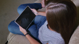 Teen Girl Watches Content On Tablet PC In Living Room stock footage