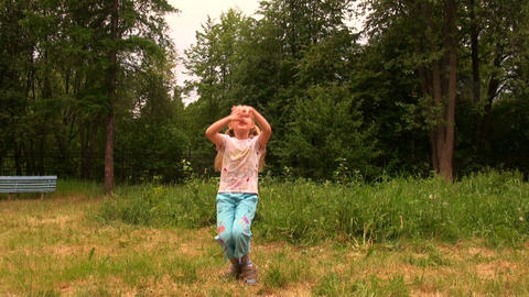Girl Dancing On The Grass stock footage