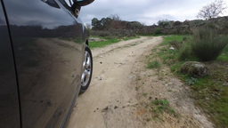 Driving Car In Rural Dirt Road, Steady Shot stock footage