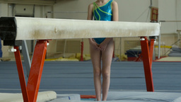 girl gymnast preparing for exercise on balance beam Footage