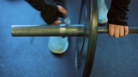 Athlete Putting Weights On Barbell At Gym Slow Mo stock footage