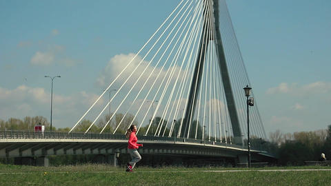 Athletic Woman Run Outdoors Promenade Near River Footage