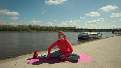 Young Brunette Woman Practicing Yoga Near River stock footage