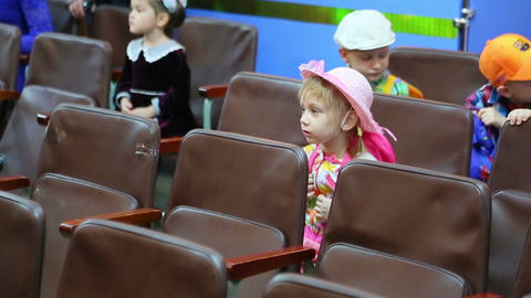 Little Girl Sitting In The Auditorium stock footage