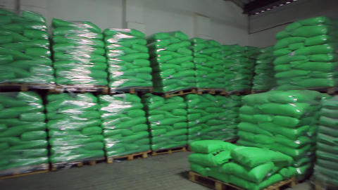 Green Bags With Products In Stock Warehouse stock footage