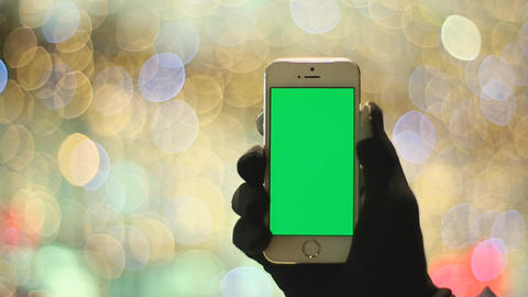 Man Using Smartphone With Green Screen In Background Light. Easy For Cut And Key stock footage