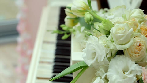White Old Beautiful Piano And Bouquet Of White Roses Focus On Flowers stock footage