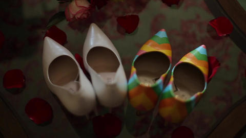 Shoes Stand On A Transparent Glass Table Indoors stock footage