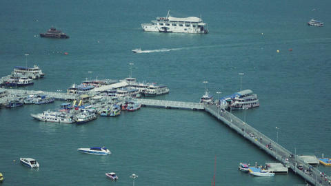 People Crossing The Bridge Between Harbor And Waterfront At Pattaya Pier stock footage