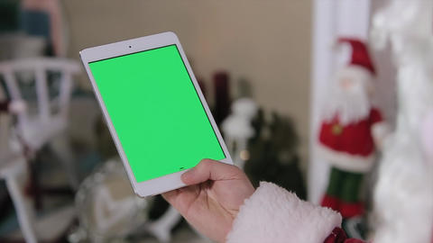 Santa Claus Work On Digital Tablet Green Screen. Tablet With Green Screen In Ver stock footage
