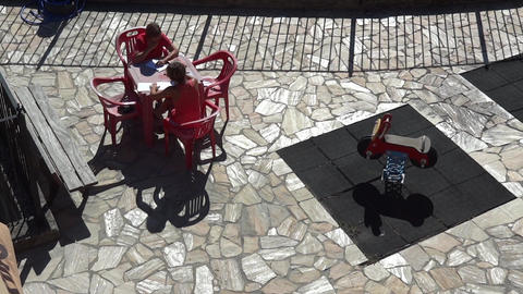 Women Sitting At A Table Plastic Red Seated On The Terrace And Write Letters To  stock footage