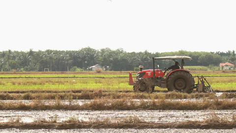 A Tractor Ploughing The Agriculture Land stock footage