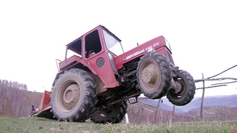 Drivers Who Pick Up His Tractor To The Rear Wheels, The Front Ones Remaining In  stock footage