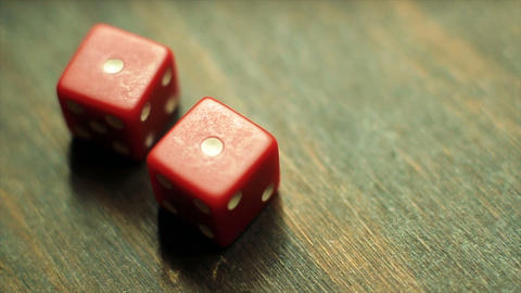 Two Red Dice Roll a Pair of Ones Footage