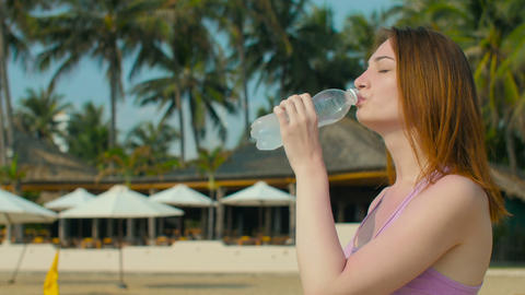 Girl Drinks Cold Water At Sunny Beach stock footage