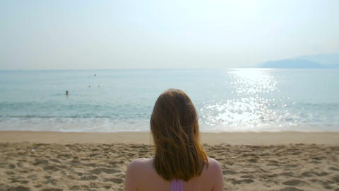 Young Beautiful Woman Sitting On The Beach, Meditation, Slow Motion stock footage