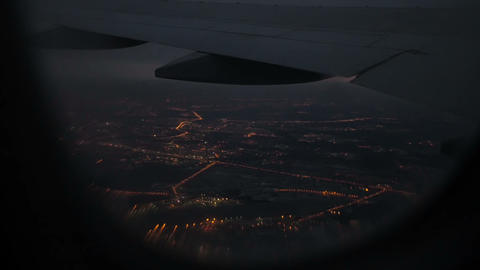 Beautiful view of night city from airplane window Footage