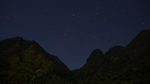 Starry Night Time Lapse Over Mountain Range stock footage