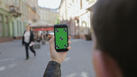 Man taking photo with camera phone in Lviv,Ukraine. Young casual man taking pict Footage
