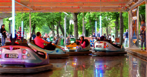 Children And Parents Having Fun On Bumper Cars Ride In Youths Public Park Footage