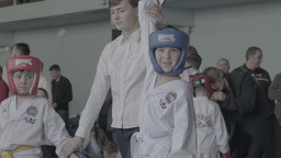 The Referee Raises The Winner's Arm-the Child In Children's Taekwondo stock footage