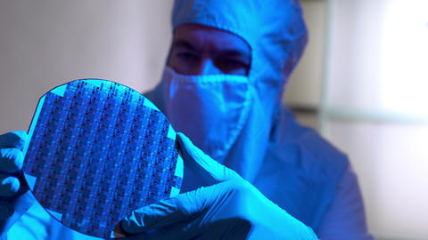 Cleanroom Tech Checking Out A Silicon Wafer Microchip Disk 4k stock footage