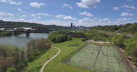 Aerial Rising View Of Pittsburgh Skyline From Washington's Landing stock footage