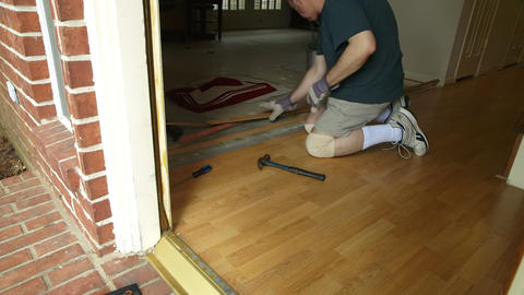DYI Project Of Removing Old Laminate Flooring stock footage
