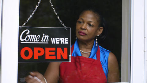 Woman Small Business Owner Opening Her Shop stock footage