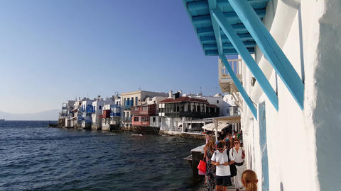 Mykonos, Greece - People Walking The Narrow Path At Little Venice stock footage