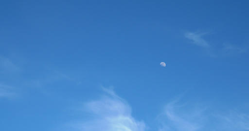Moon Visible In Daylight Blue Sky With White Soft Clouds stock footage