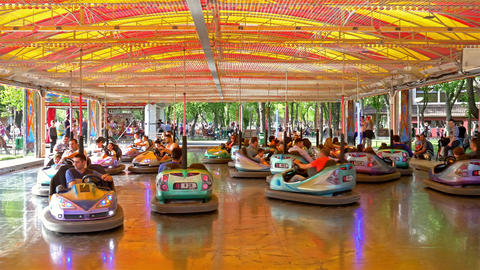 Children And Parents Having Fun On Bumper Cars Ride stock footage