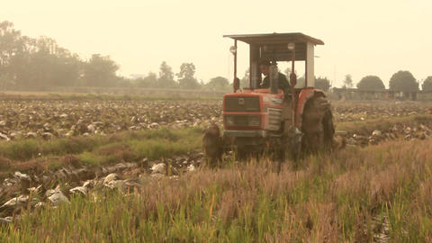 Tractor Working On Field stock footage