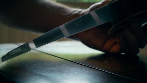 closeup of man looking at microfiche film 4k Footage