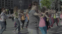 People Dance A Merry Dance On The Street. Aerobics. Fitness stock footage