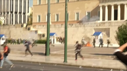 POLICE GIVE CHASE TO PROTESTERS THROWING PROJECTILES OUTSIDE GREEK PARLIAMENT Footage