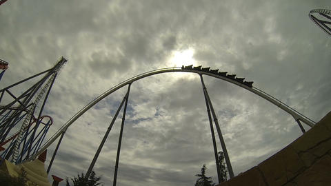 Roller Coaster Ride Against Cloudy Sun stock footage