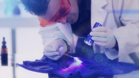 CSI Looking For Evidence With UV Light Lens Flare stock footage